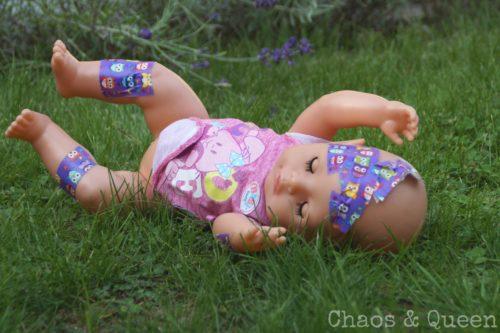 Puppe mit Pflaster